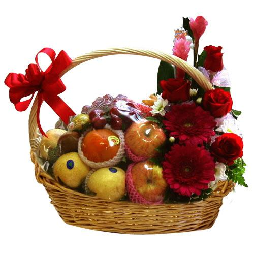 Soft Simple Assorted Fruit Basket designed with Flowers